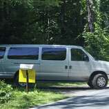 """A van is driven from Tall Pines Lane onto  Curry Road as film crews worked in the area  on Wednesday, July 27, 2011.  Crews were filming scenes for the movie """"The Place Beyond the Pines"""".  (Paul Buckowski / Times Union)"""