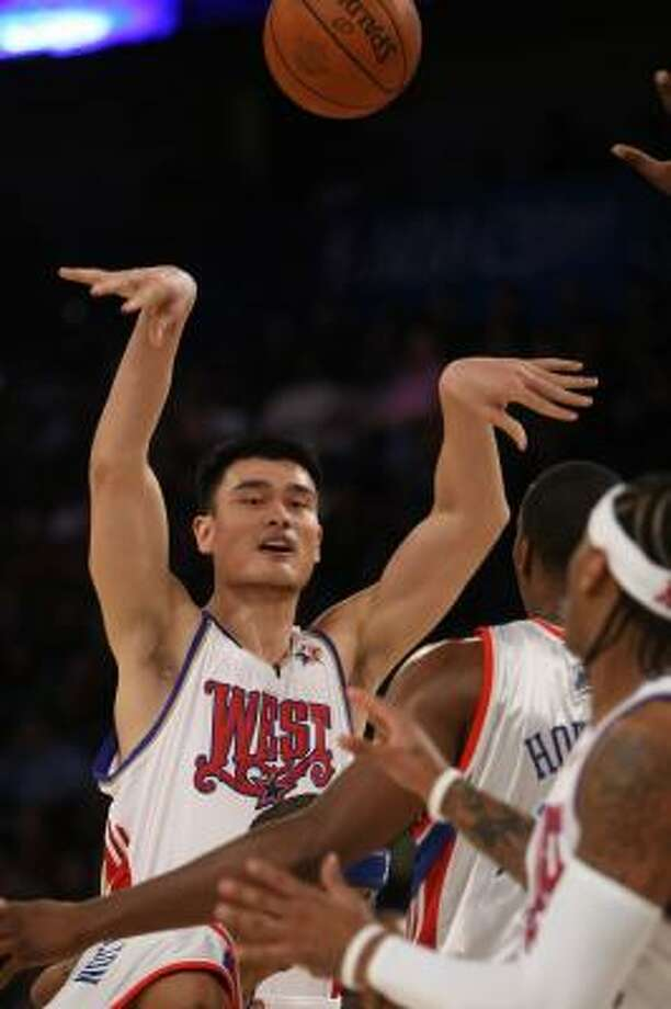 Rockets center Yao Ming passes out to a teammate in the first half of Sunday's All-Star Game. Photo: TIMOTHY A. CLARY, GETTY IMAGES