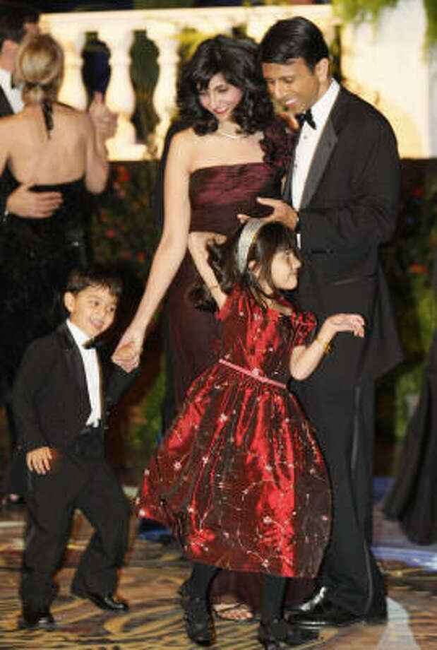 Louisiana Gov. Bobby Jindal and first lady Supriya dance with their son Shaan, and daughter Selia, during the Inaugural Ball Jan. 14 in Baton Rouge, La. Supriya Jindal is the second youngest wife of a sitting U.S. governor Photo: Arthur D. Lauck, Associated Press