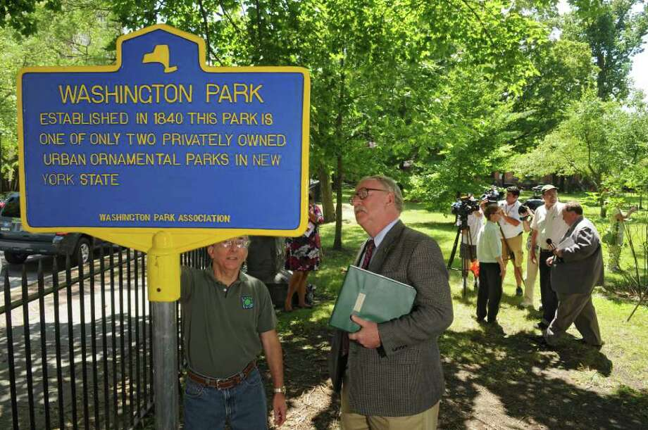 A historic marker indicating that Washington Park is one of only two privately owned and maintained urban ornamental parks in the state, was unveiled on Wednesday July 27, 2011 in Troy, NY.  (Philip Kamrass / Times Union) Photo: Philip Kamrass / 00014021A