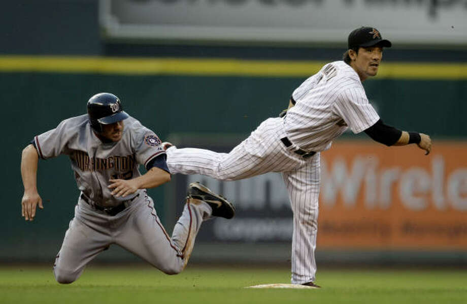 Kaz Matsui finishes a double play after Rob Mackowiak tries to take him out in the second inning. Photo: Karen Warren, Chronicle