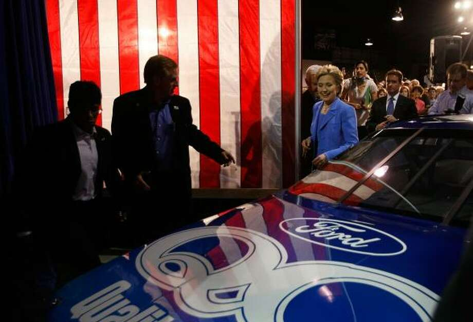 Sen. Hillary Clinton checks out race cars Saturday at the North Carolina Auto Racing Hall of Fame in Mooresville. Photo: JOE RAEDLE, GETTY IMAGES