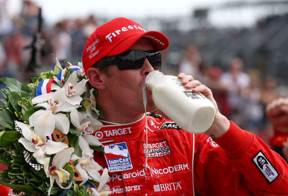 Scott Dixon drinks the ceremonial winner's milk in victory lane after his win in the Indianapolis 500. Photo: Robert Laberge, Getty Images