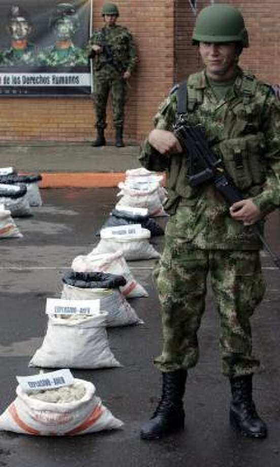 Colombian soldiers guard packs of ammonium nitrate/fuel oil explosives seized from FARC guerrillas near Bogota. Photo: INALDO PEREZ, AFP/GETTY IMAGES