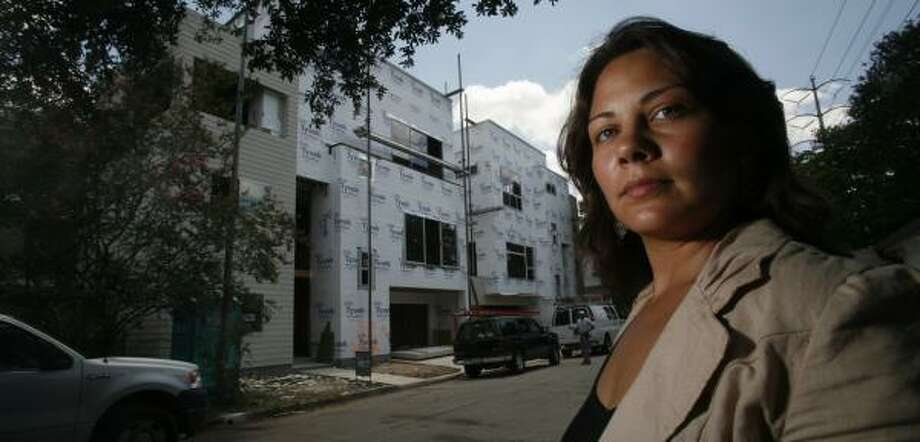 Morgana Davila, with Metropolitan Design Group, said her company recently had to rebid the cost of building a custom home. Photo: STEVE UECKERT, CHRONICLE