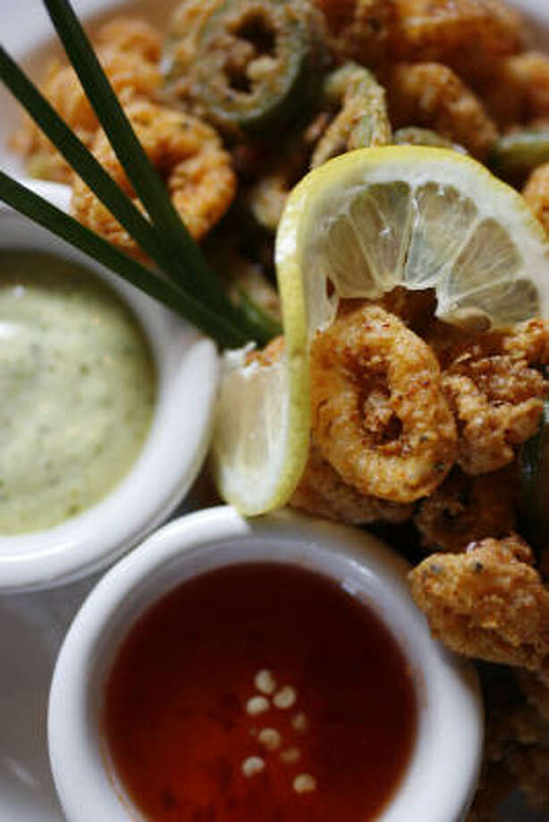 Kenzo's seven-spice calamari appetizer is served with dips of sambal and aioli. Photo: Karen Warren, Chronicle