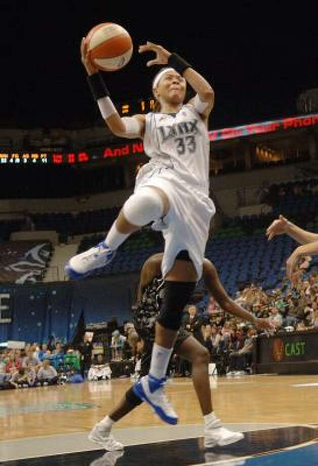 Minnesota Lynx's Seimone Augustus takes the ball to the hoop during the third quarter against the San Antonio Silver Stars in Minneapolis on Friday. Augustus scored 20 points as the Lynx won 78-68. Photo: Janet Hostetter, AP