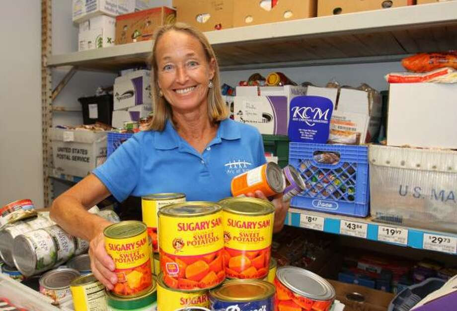 Cheryl Crozier, director of the food pantry at Katy Christian Ministries, 5304 East Fifth Street in Katy, stocks canned vegetables. Photo: Suzanne Rehak