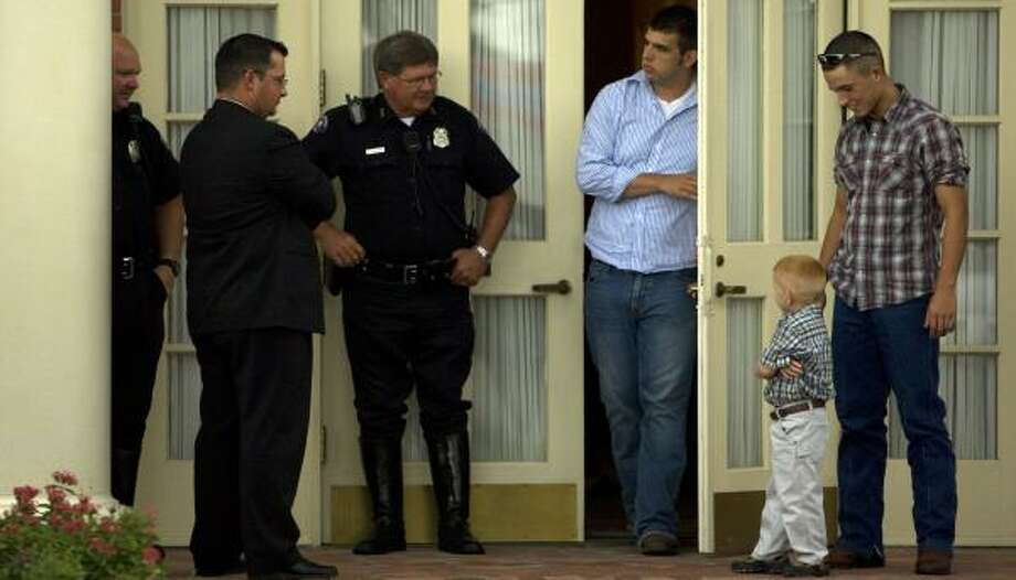 Michael Melton, 18, steps outside his mother's viewing Tuesday at Grand View Funeral Home & Memorial Park in Pasadena to speak with police officers on hand to help family members feel protected from James Quick. Quick is charged in her death and has been released on bond. Photo: JOHNNY HANSON, CHRONICLE