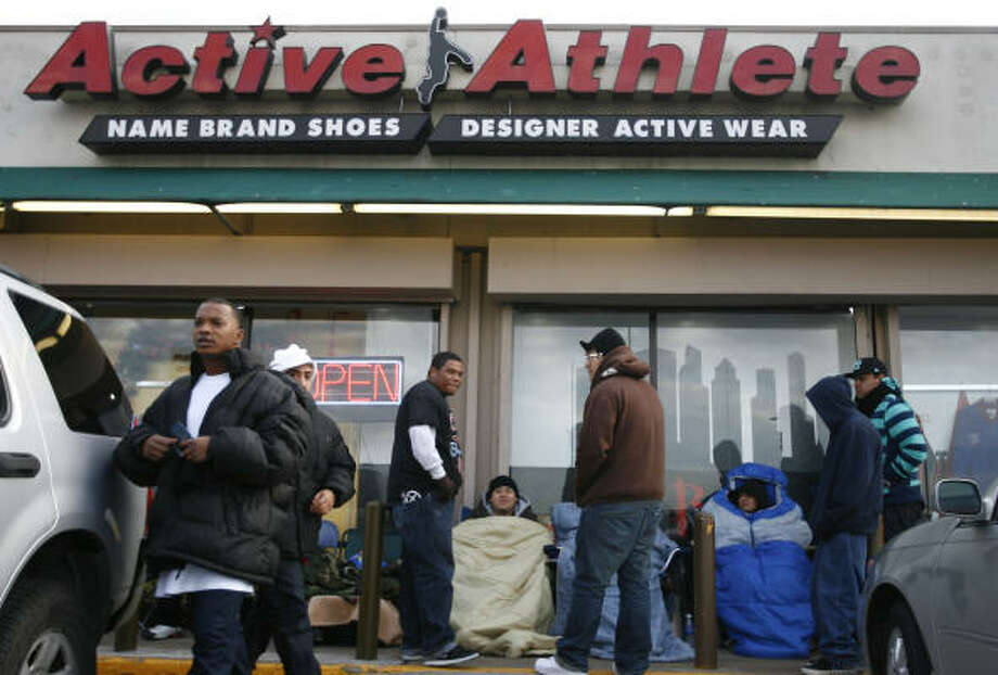 Twenty-two sneaker fans are braving the cold  to hold their place in line at  Active Athlete on Cullen Boulevard, the only location in Texas that's selling the coveted 23rd anniversary Air Jordan shoe. Photo: Sharon Steinmann, Chronicle