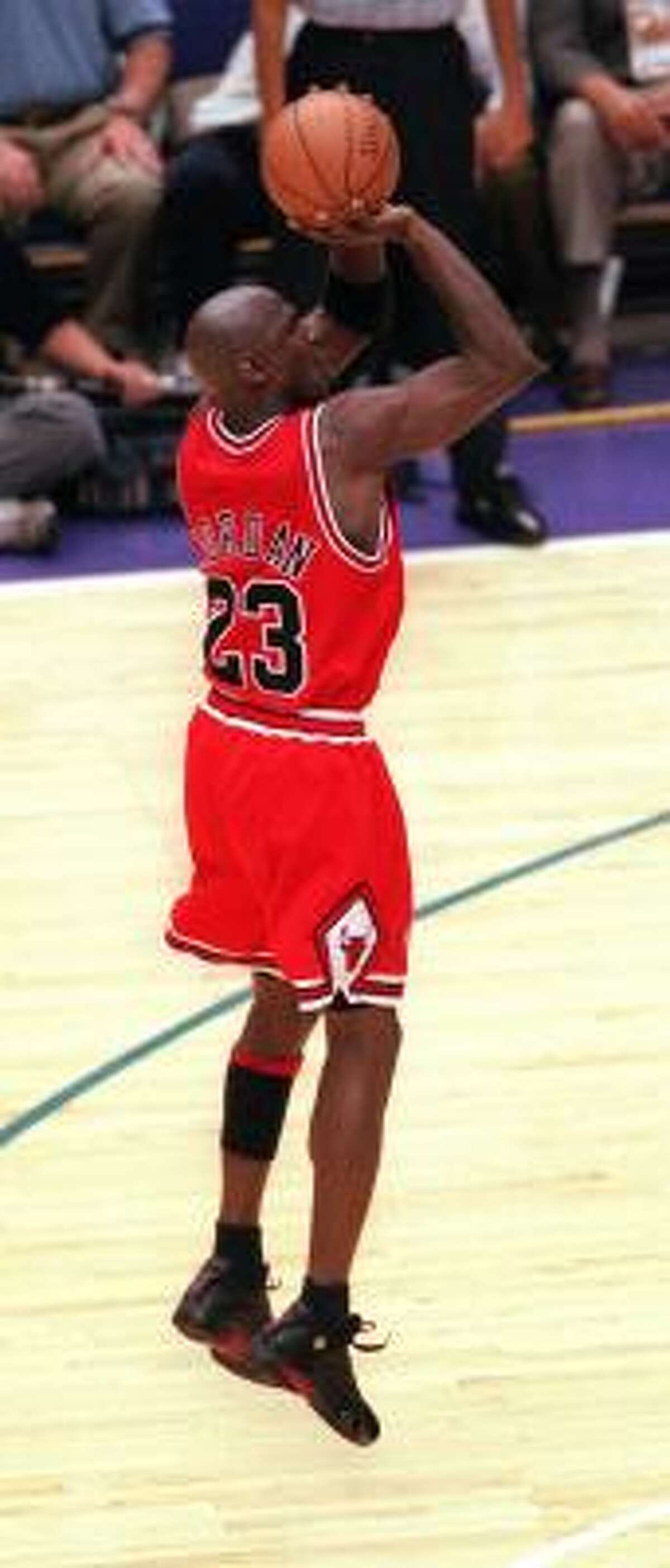 Michael Jordan, wearing the shoes that bear his name, fires in the winning shot in the 1998 NBA Finals.