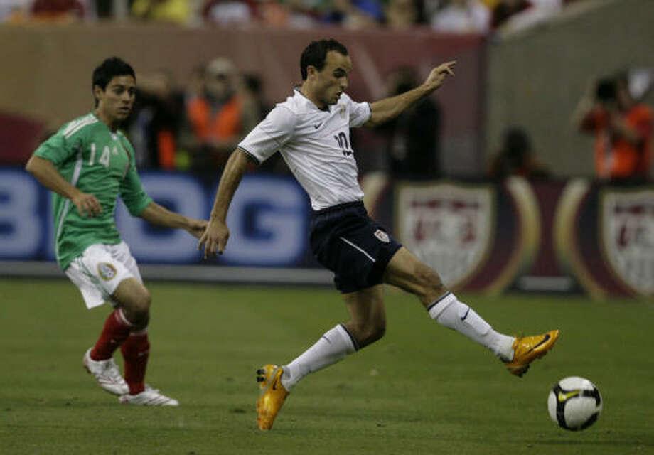 U.S. striker Landon Donovan has scored four goals in nine appearances against Mexico. Photo: Julio Cortez, Chronicle