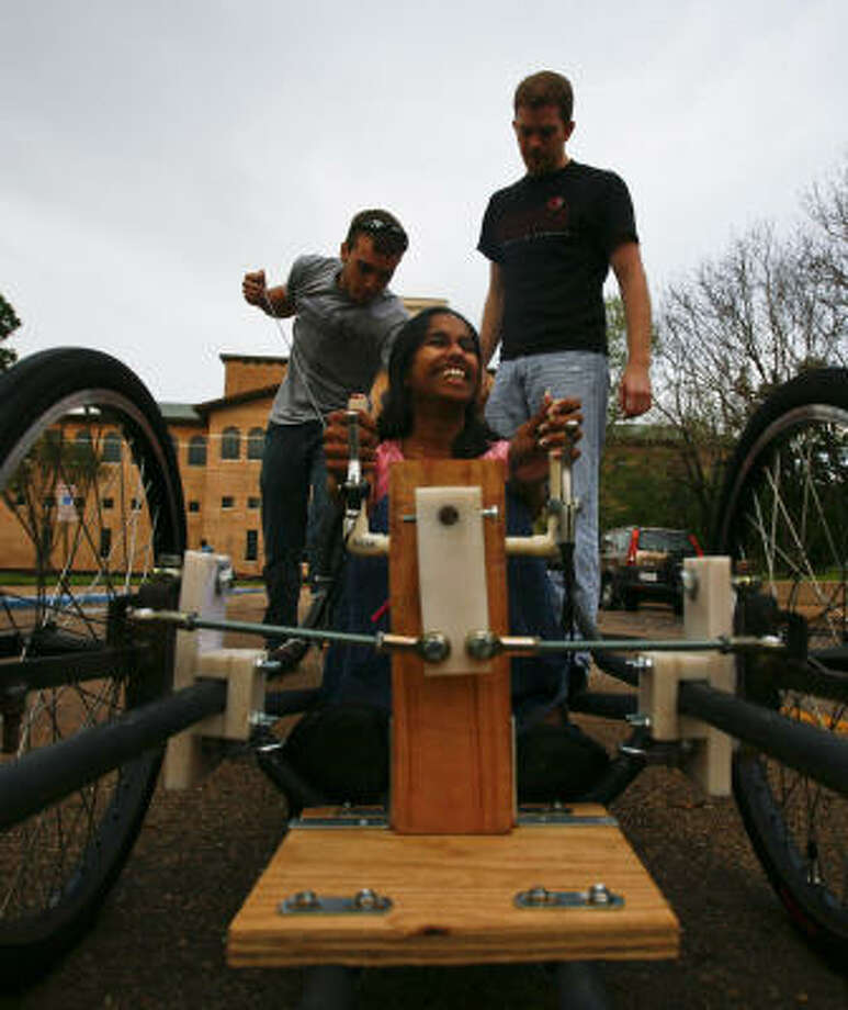 With Avanthi Kodur in the driver's seat, University of Houston's Brandon Marbach, left, and James Smith troubleshoot engine problems. Photo: Michael Paulsen, Chronicle