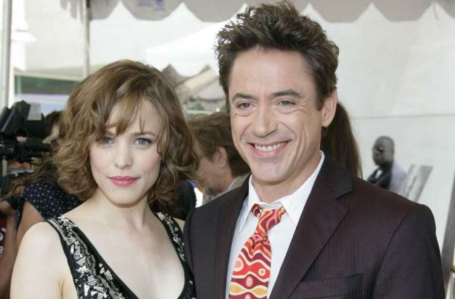 "Actor Robert Downey Jr., seen here with actress Rachel McAdams, is in talks to replace Tom Cruise as bloodsucker Lestat in a prequel to 1994 movie ""Interview With the Vampire."" Photo: Denis Poroy, Associated Press"