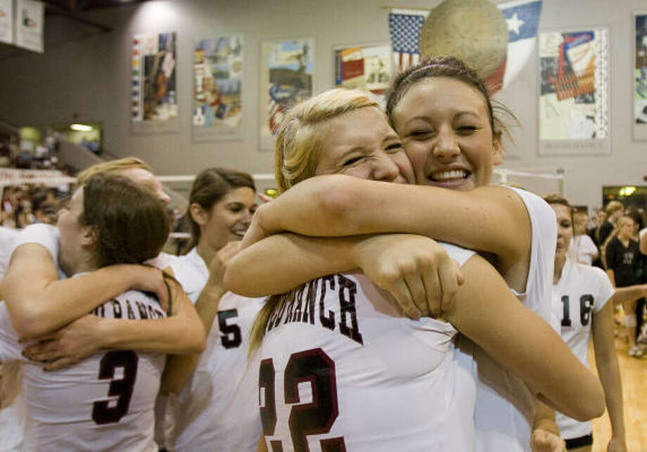 Cinco Ranch's Demi Clinch, right, hugs teammate Jennifer Sanders after the final point of the Class 5A regional volleyball tournament Saturday. Photo: Smiley N. Pool, Houston Chronicle