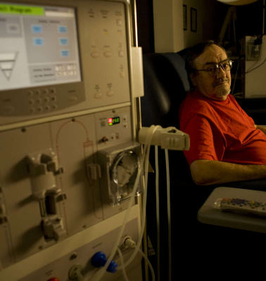 Bruce Garren must travel to Tomball for dialysis, even though there is a treatment center in his hometown of Magnolia. That one is waiting for certification to accept Medicare and Medicaid patients — and has been waiting for more than a year. Photo: Eric Kayne, Chronicle