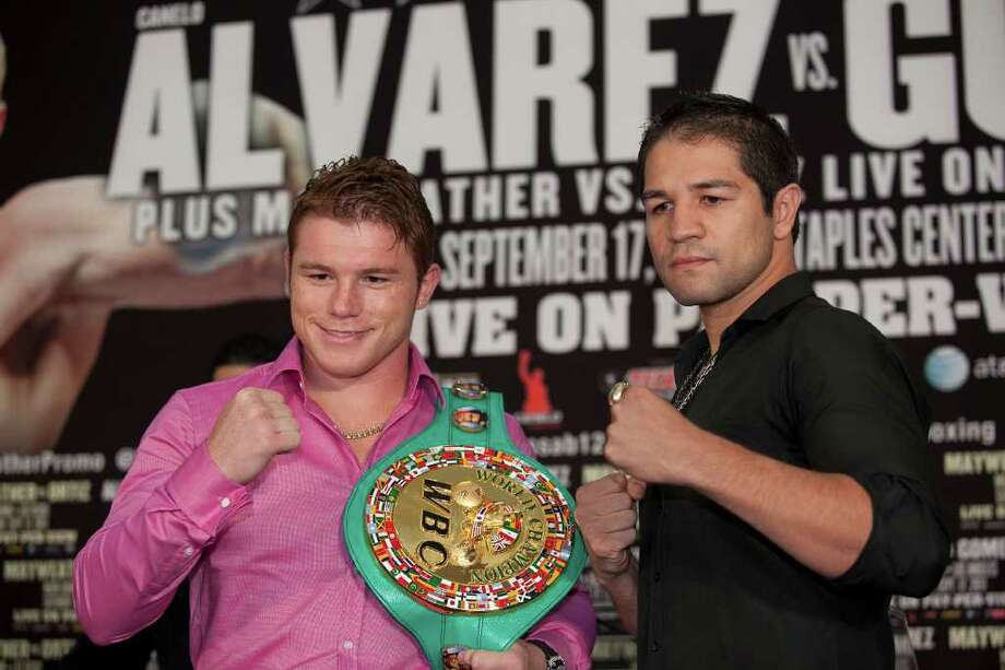 World Boxing Council super welterweight world champion Canelo Alvarez, left, anounces his fight with Alfonso Gomez, right, Wednesday noon July 27, 2011 at the PlazAmericas Hall in Houston. The fight will be Sept. 17 in Los Angeles.  Nathan Lindstrom/For the Chronicle  ©2010 Nathan Lindstrom Photo: Nathan Lindstrom, Freelance / ©2011 Nathan Lindstrom