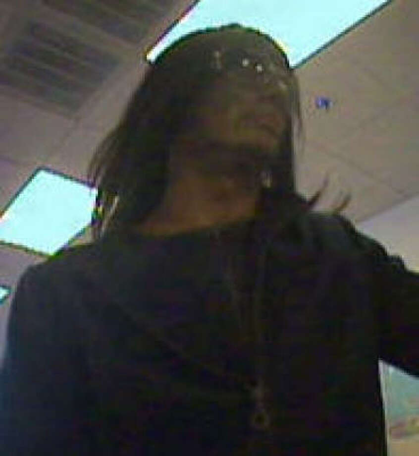 The person in this image, taken by surveillance video, is wanted in Thursday's robbery of a Wells Fargo bank in Friendswood. Police said the robber was a man dressed as a woman. Photo: Friendswood Police Department