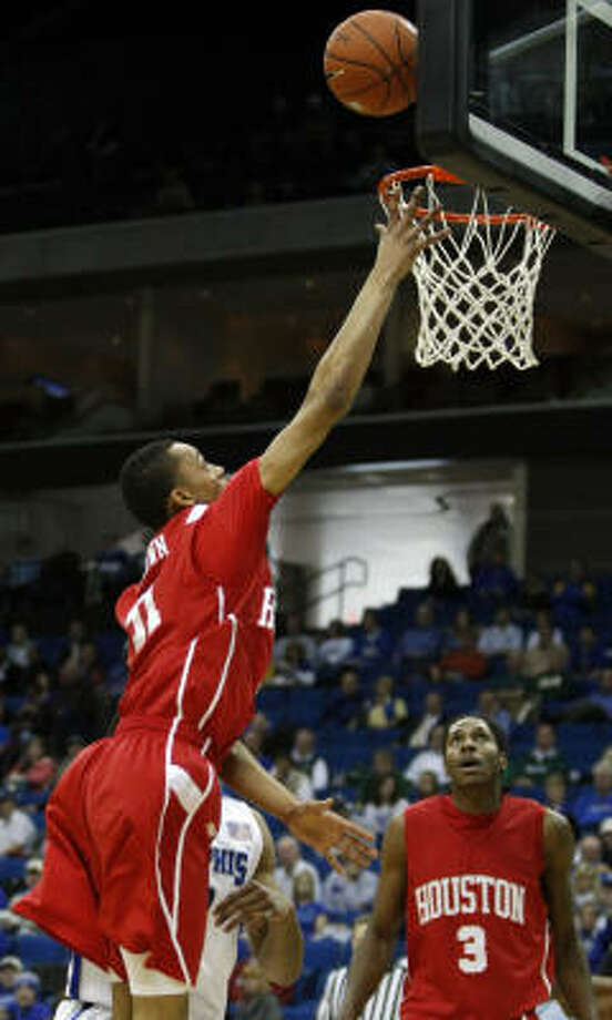 Houston's Adam Brown puts in a short shot in the lane against Memphis on Thursday. Photo: Cory Young, AP