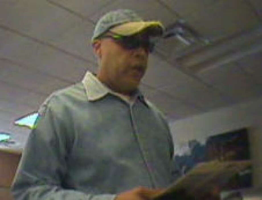 The man in this image, taken today by surveillance video, is wanted in the robbery of a Wells Fargo bank. The same man is suspected in the March 8 robbery of a Chase Bank in Houston. Photo:  FBI
