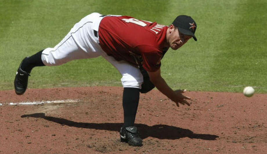 Astros righthander Roy Oswalt allowed two runs over six innings Sunday. Photo: Julio Cortez, Chronicle