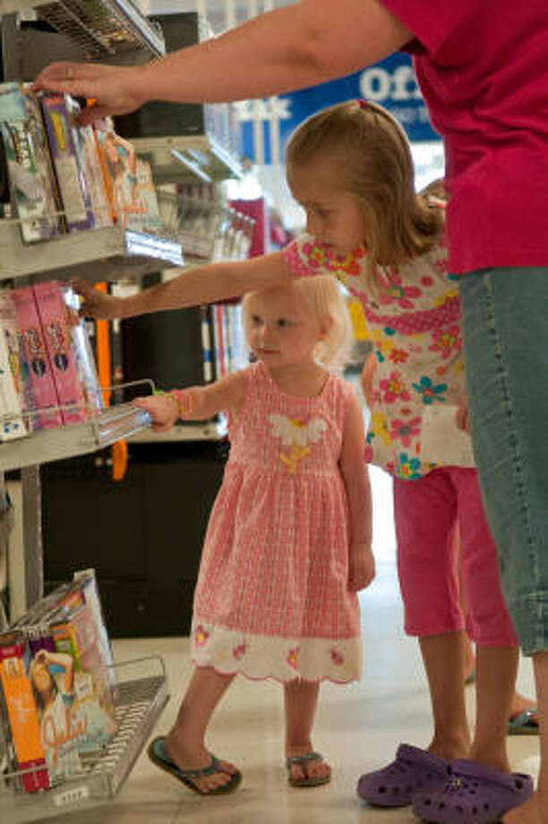 Abby Watson, 2, and her sister Hailey, 8, shop with their mother, Emily Watson, for school supplies at OfficeMax. Photo: John Jiles:, Houston Chronicle
