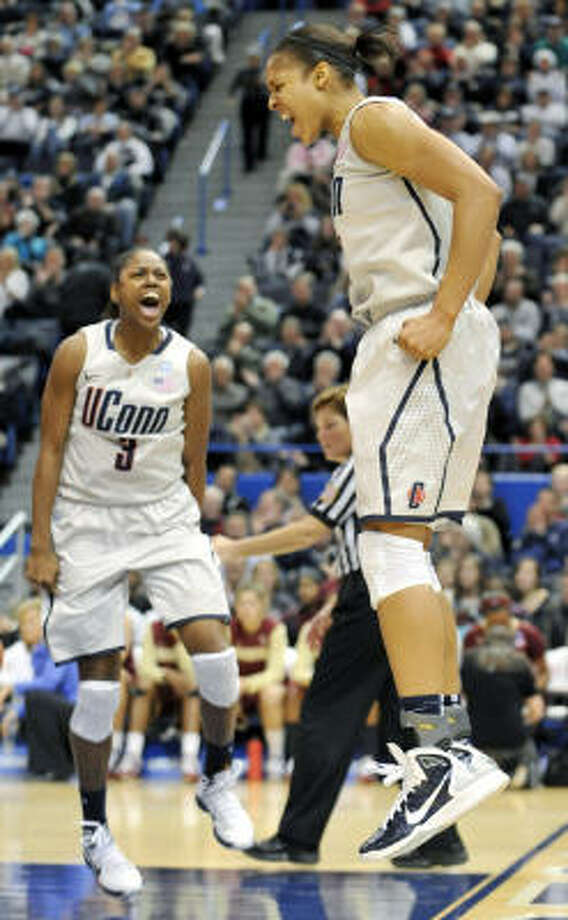 Connecticut forward Maya Moore, right, reacts with teammate Tiffany Hayes (3) during the squad's record-breaking victory on Tuesday night. Photo: Jessica Hill, AP