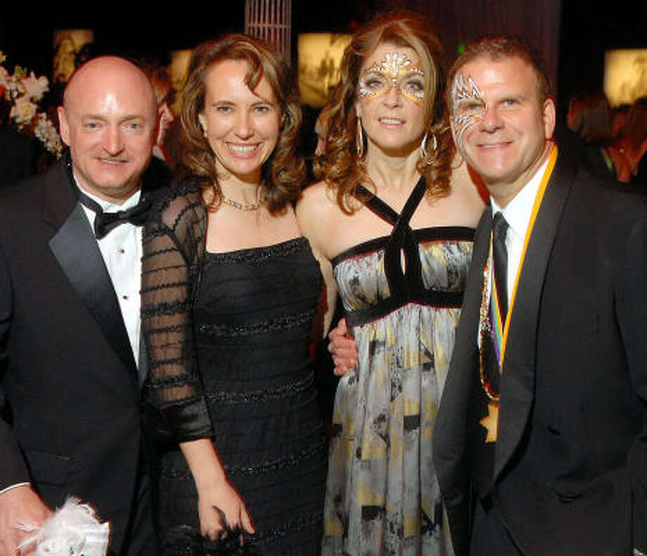 "In happier times, Gabrielle Giffords, second from left, and her husband, NASA astronaut Mark Kelly, left, celebrated with Paige and Tilman Fertitta at ""The San Luis Salute,"" a benefit for UTMB during Mardi Gras in February 2009. Photo: Dave Rossman, Chronicle"