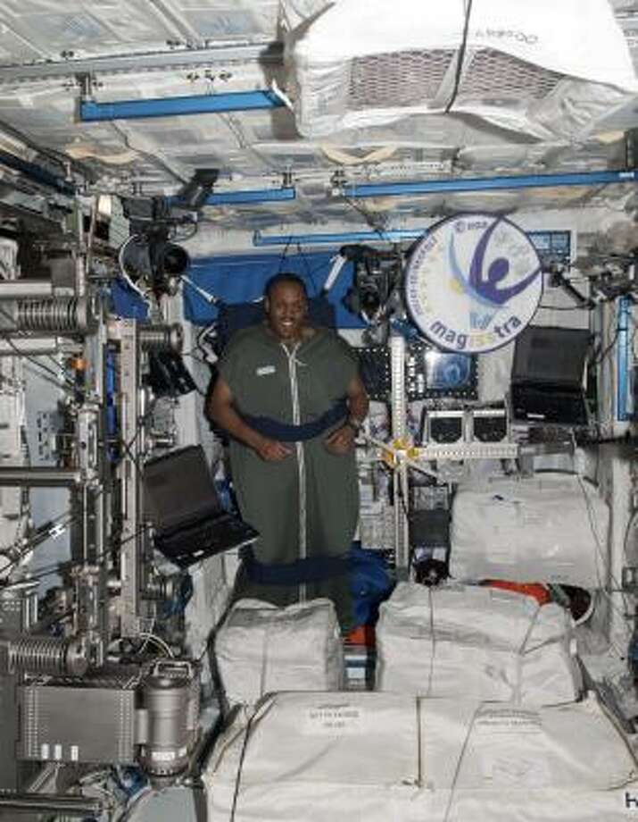 Astronaut Alvin Drew models his sleeping bag for an earthbound audience. Photo: Associated Press