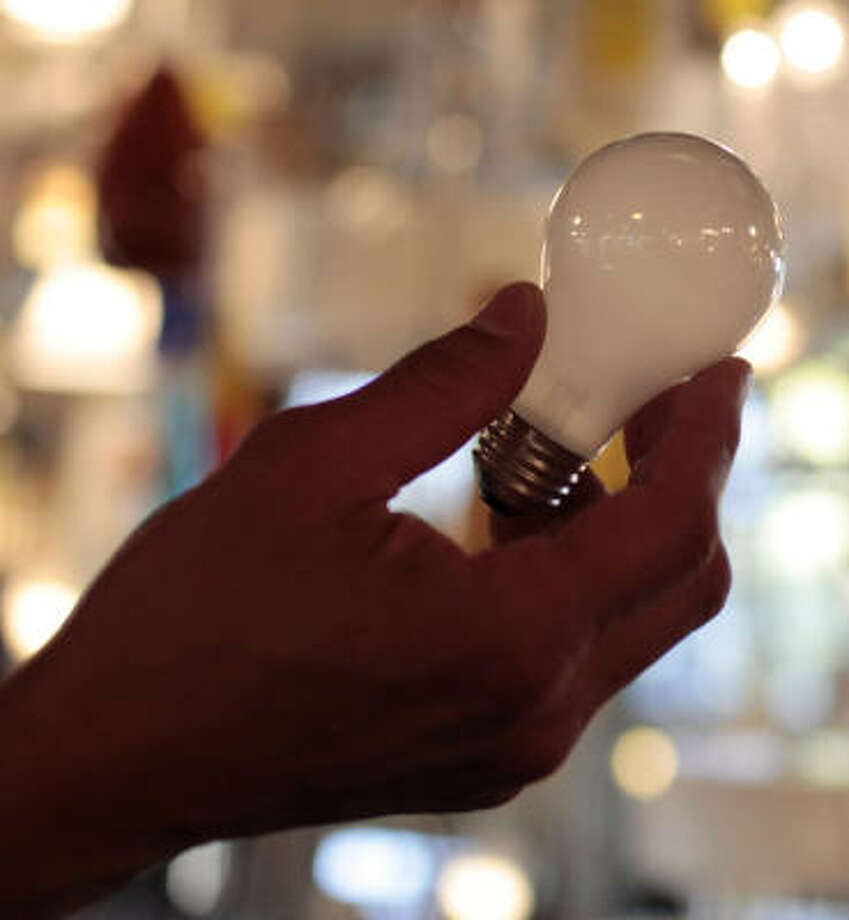 This 100-watt incandescent light bulb is used across the country, but a 2007 law places energy-efficiency restrictions on them, encouraging use of fluorescent bulbs. Photo: Jae C. Hong, Associated Press