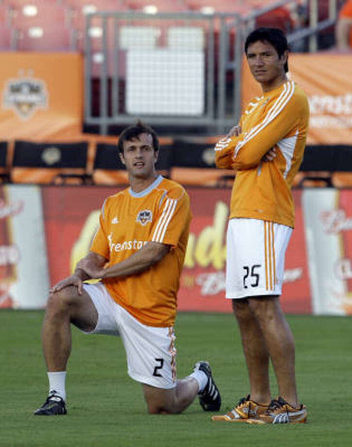 Dynamo forward Brian Ching, right, missed Saturday's season opener against Philadelphia with a strained right hamstring but might return Friday against Seattle. Photo: Bob Levey, Getty Images