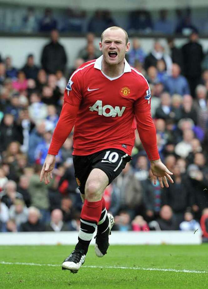 Manchester United's Wayne Rooney celebrates after he scored his side's equalising goal from the penalty spot during the English Premier League soccer match at Ewood Park, Blackburn Saturday May 14, 2011. (AP Photo/Martin Rickett, PA) UNITED KINGDOM OUT NO SALES NO ARCHIVE NO INTERNET/MOBILE USAGE WITHOUT FAPL LICENCE - SEE IPTC SPECIAL INSTRUCTIONS FIELD FOR DETAILS Photo: Martin Rickett, SUB / PA
