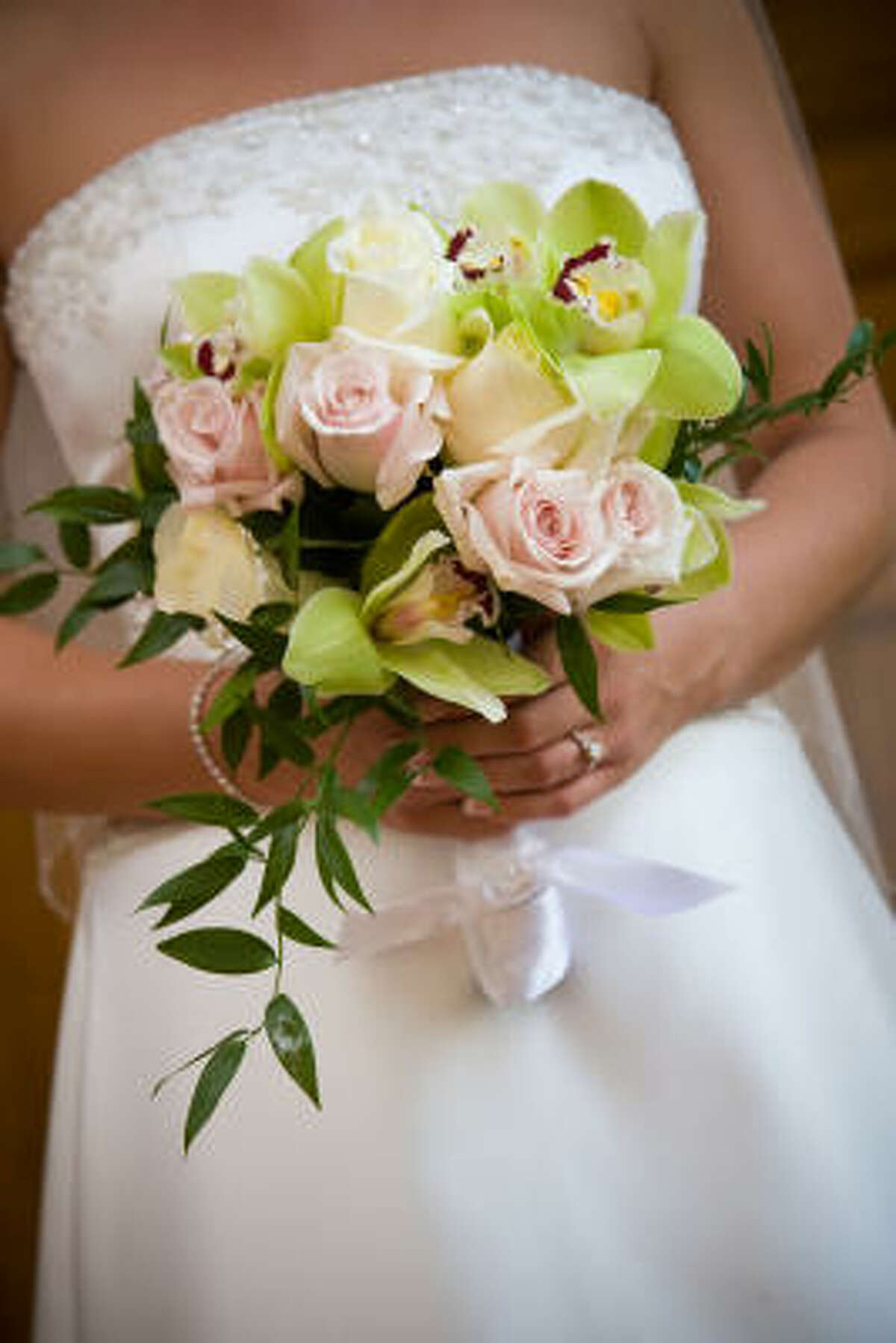 The traditional bridal white and bouquet may be thrown out like rice for some feminists.