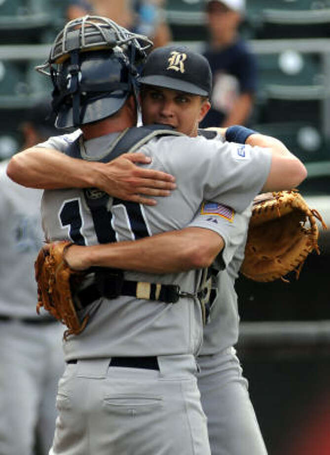 Rice pitcher Mike Ojala, right, hugs Rick Hague after the last out during the Owls 9-1 win over Louisiana-Lafayette. Photo: Patrick Meredith, For The Chronicle
