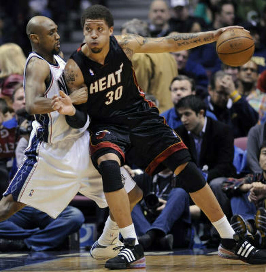 A person briefed on the situation says Heat forward Michael Beasley is battling depression-related issues. Photo: Bill Kostroun, AP