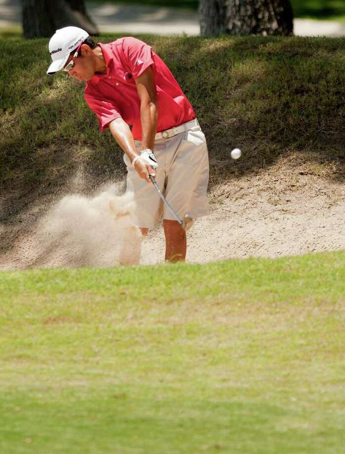 Antonian standout Alex Bissaro, 17, digs himself out of a bunker as he maintains his lead in the Greater San Antonio Junior Championship at Brackenridge Golf Course on Wednesday, July 27, 2011. Bissaro sits at 1-under 141 heading into today's final round. Photo: Darren Abate/Special To The Express-News