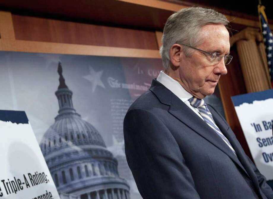 Senate Majority Leader Harry Reid of Nev. pauses during a news conference on debt ceiling legislation, Wednesday, July 27, 2011, on Capitol Hill in Washington.  (AP Photo/Evan Vucci) Photo: Evan Vucci