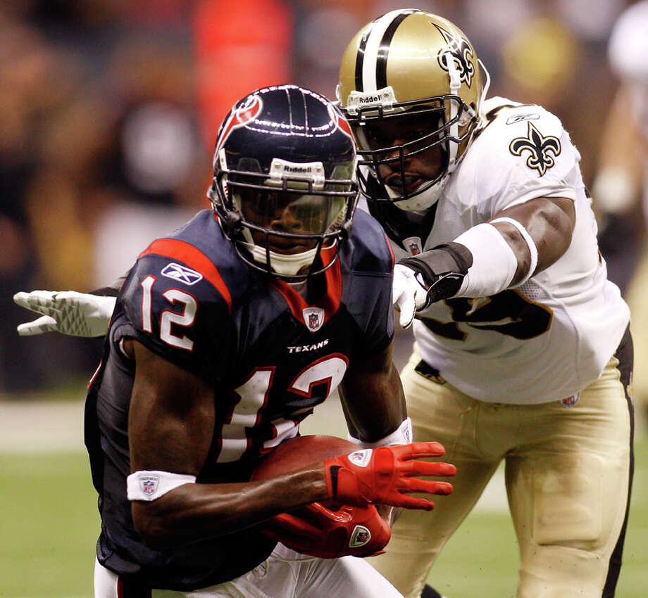Texans receiver Jacoby Jones, seen here being tackled by the Saints Anthony Waters in August 2010, signed a three-year contract and said he never considered leaving Houston. Photo: Chris Graythen/Getty Images / 2010 Getty Images