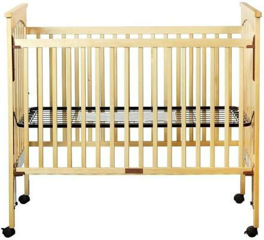 Malfunctions in now-banned drop-side cribs can create a space for a child to become entrapped, strangled or suffocated, or fall out of the crib. Photo: AP