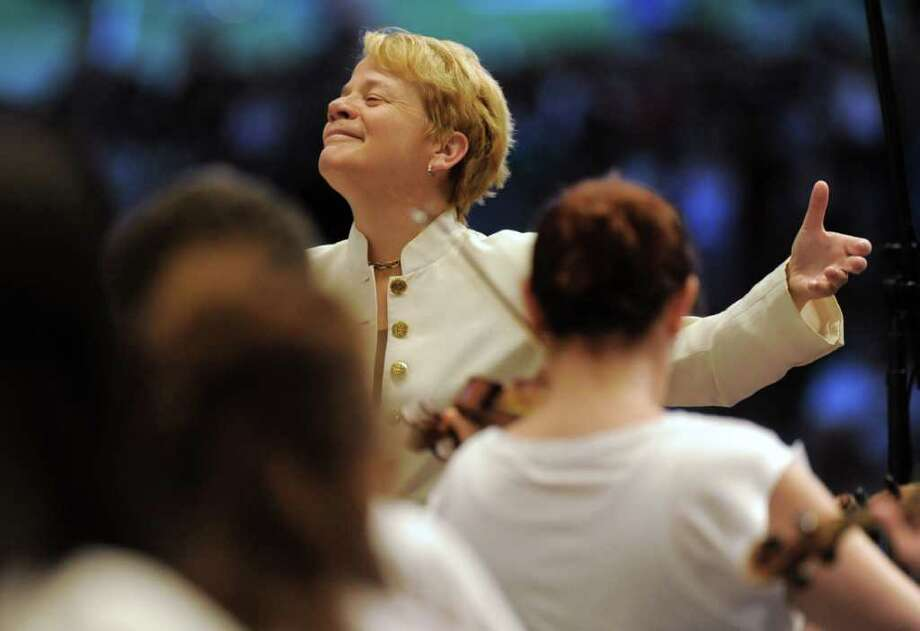 Marin Alsop conducts the Philadelphia Orchestra during a performance at Saratoga Performing Arts Center in Saratoga Springs, N.Y. on Wednesday, July 27, 2011.  (Lori Van Buren / Times Union) Photo: Lori Van Buren