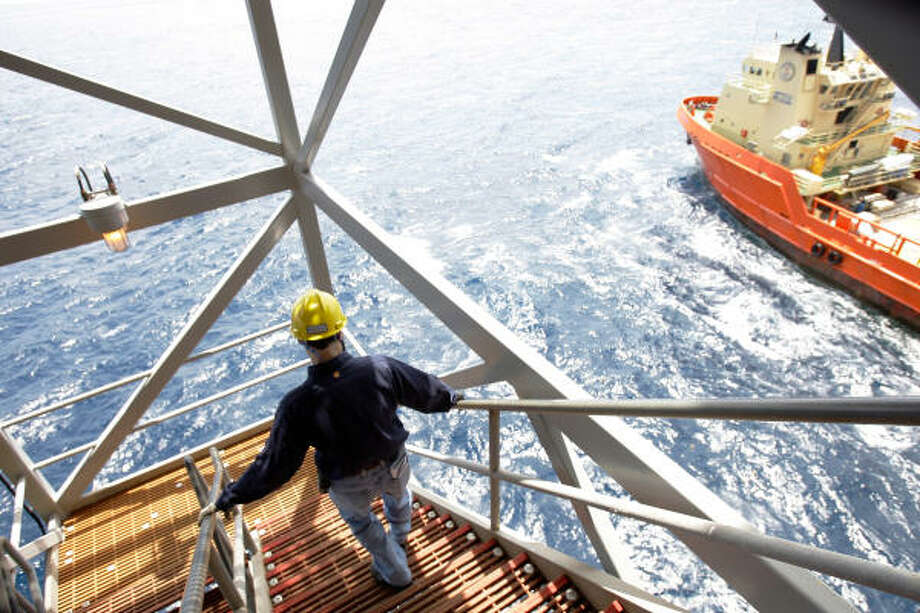 Shell's new Perdido platform has begun pumping oil 200 miles off Texas. John Lodge, Shell utilities team leader, heads to a lower deck on the 50,000-ton structure, whose maximum output capacity is 100,000 barrels of crude oil and 200 million cubic feet of natural gas per day. Photo: Melissa Phillip :, Chronicle