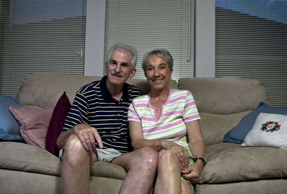 Marc Katz and Lu Poole have rarely missed a Saturday night date since they were married almost 16 years ago. Photo: James Nielsen, Chronicle