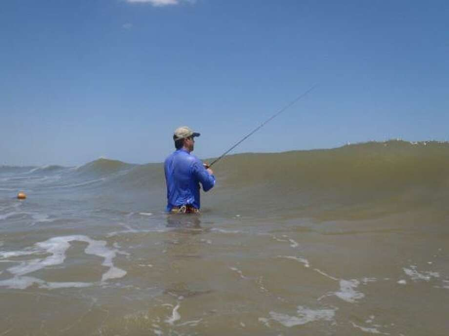 Wading the open surf provides accessible and inexpensive light-tackle fishing for thousands of Texas anglers — even on crowded holiday weekends. Photo: Joe Doggett, For The Chronicle