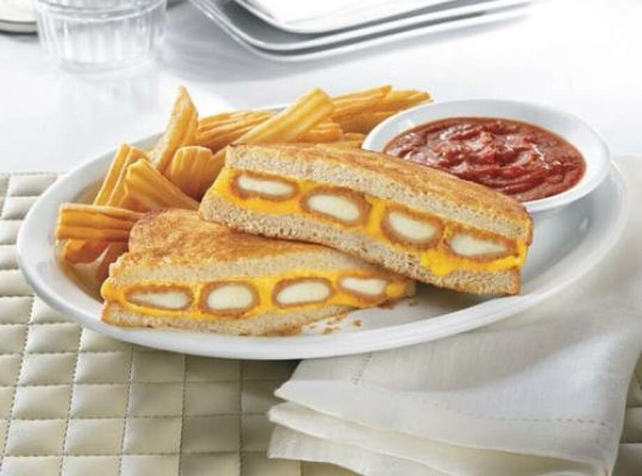 "Denny's foray into the ""Crazy Sandwich Race"" includes a lot of cheese and a lot of sodium. Photo: DENNY'S"