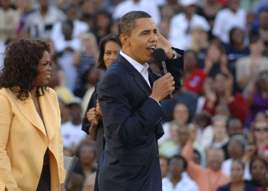 Sen. Barack Obama, his wife, Michelle, and Oprah Winfrey take the stage in Columbia, S.C., on Sunday. Photo: Stephen Morton, Getty Images