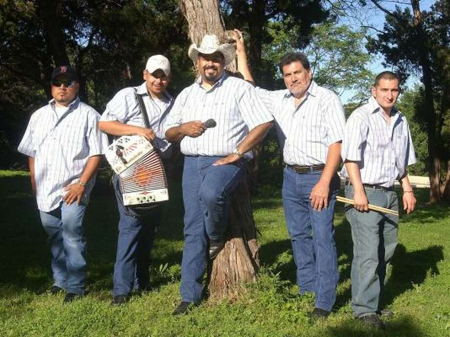 Members of the Tejano band Lumbre, from left, Pedro Rodriguez, Mario Vigil, Gerald Quezada, Thomas Guerra Jr. and Chris Rivera pose before a concert this month in Waco. Photo: JERRY LARSON, WACO TRIBUNE-HERALD