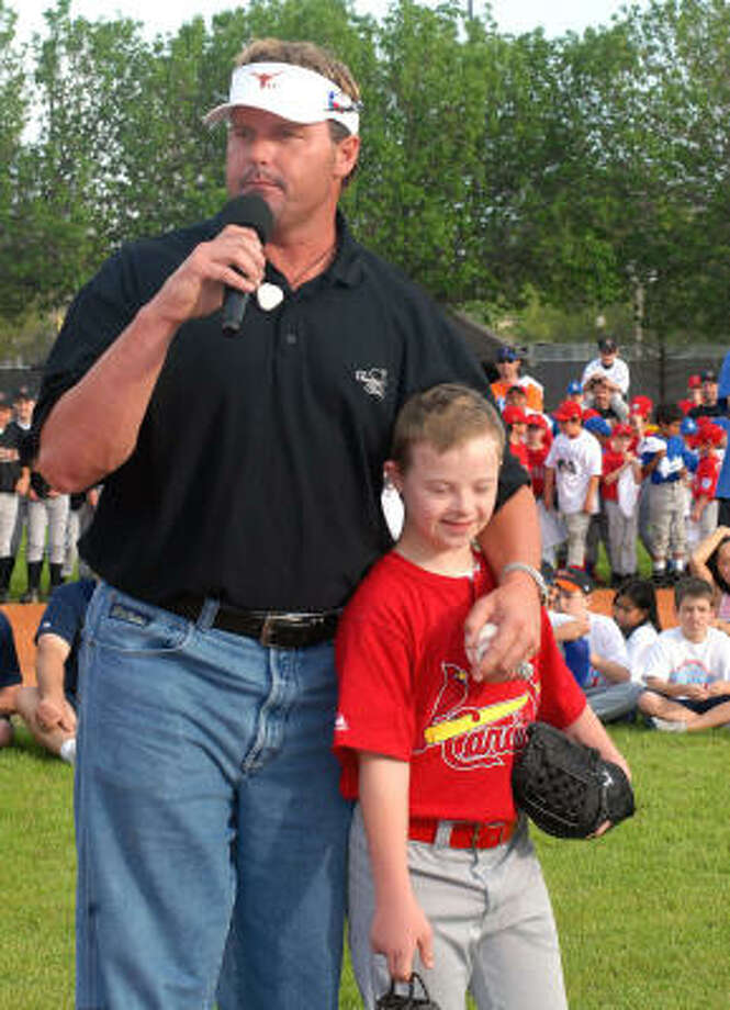Roger Clemens of the Houston Astros threw the first pitch to Jack Krueger, 12,  catcher for the Dream League Cardinals. Jack caught Clemens' first pitch to open the First Colony Little League season. Clemens praised Jack for his talent as a catcher. Photo: Ernie Chan, For The Chronicle