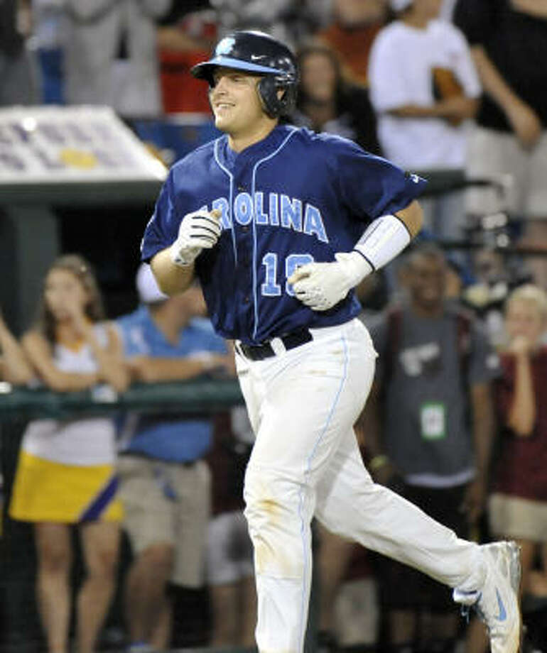 North Carolina's Tim Federowicz smiles as he rounds the bases after hitting a grand slam against LSU in the ninth inning. Photo: Ted Kirk, AP