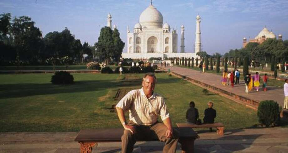 Houstonian Mike Lamson rests on a bench in front of the Taj Mahal in Agra, India. Photo: COURTESY OF MIKE LAMSON