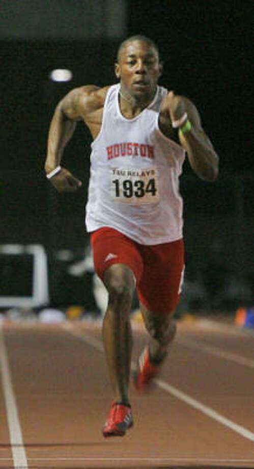 Ex-University of Houston sprinter Preston Perry, right, will continue to chase his dream today at the Olympic trials. Photo: BEN DESOTO, Houston Chronicle